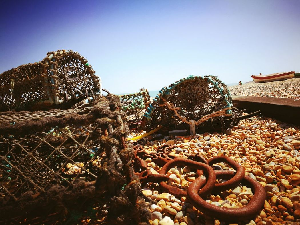 No People Fishing Net Outdoors The Great Outdoors - 2017 EyeEm Awards Worldaroundme Britain British Summer Kent Kent England Lobster Baskets Lobster Pot Pebblebeach Boatonthebeach Rustic_world Close-up Chain Rusty Chain