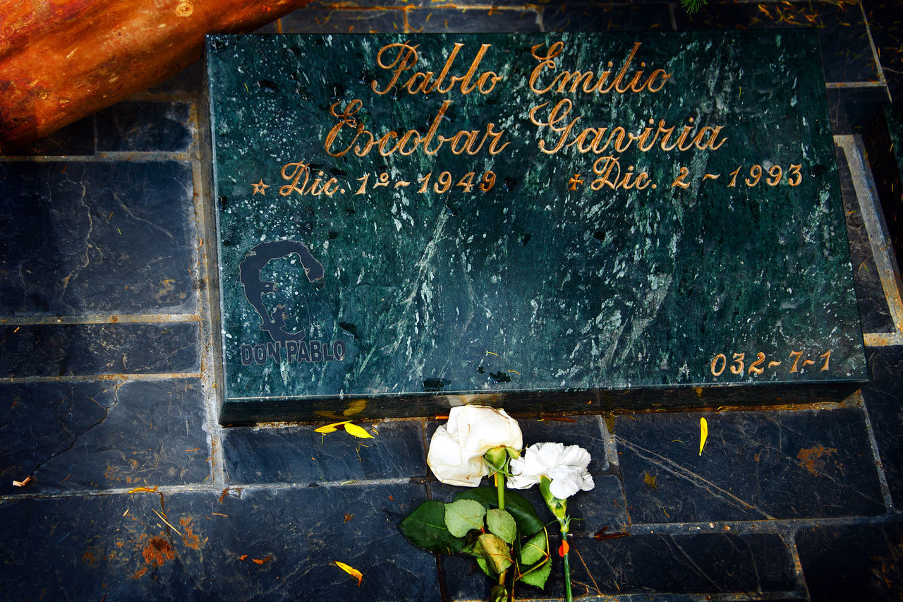 The grave of legendary Medellin cartel leader Pablo Escobar in Medellin, Colombia. Antioquia Blackboard  Cartel Cementery City Cocaine Colombia Criminal Day Dead Death Drugs Escobar Flower Gang Grave Legendary Medellín Outdoors Pablo PabloEscobar Sorrow Text Tomb Urban