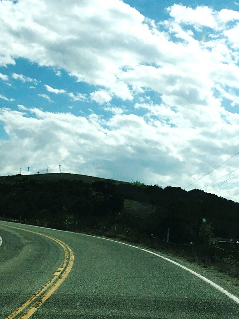 road, transportation, the way forward, highway, landscape, sky, curve, no people, street, nature, scenics, winding road, cloud - sky, outdoors, day, mountain, beauty in nature, tree