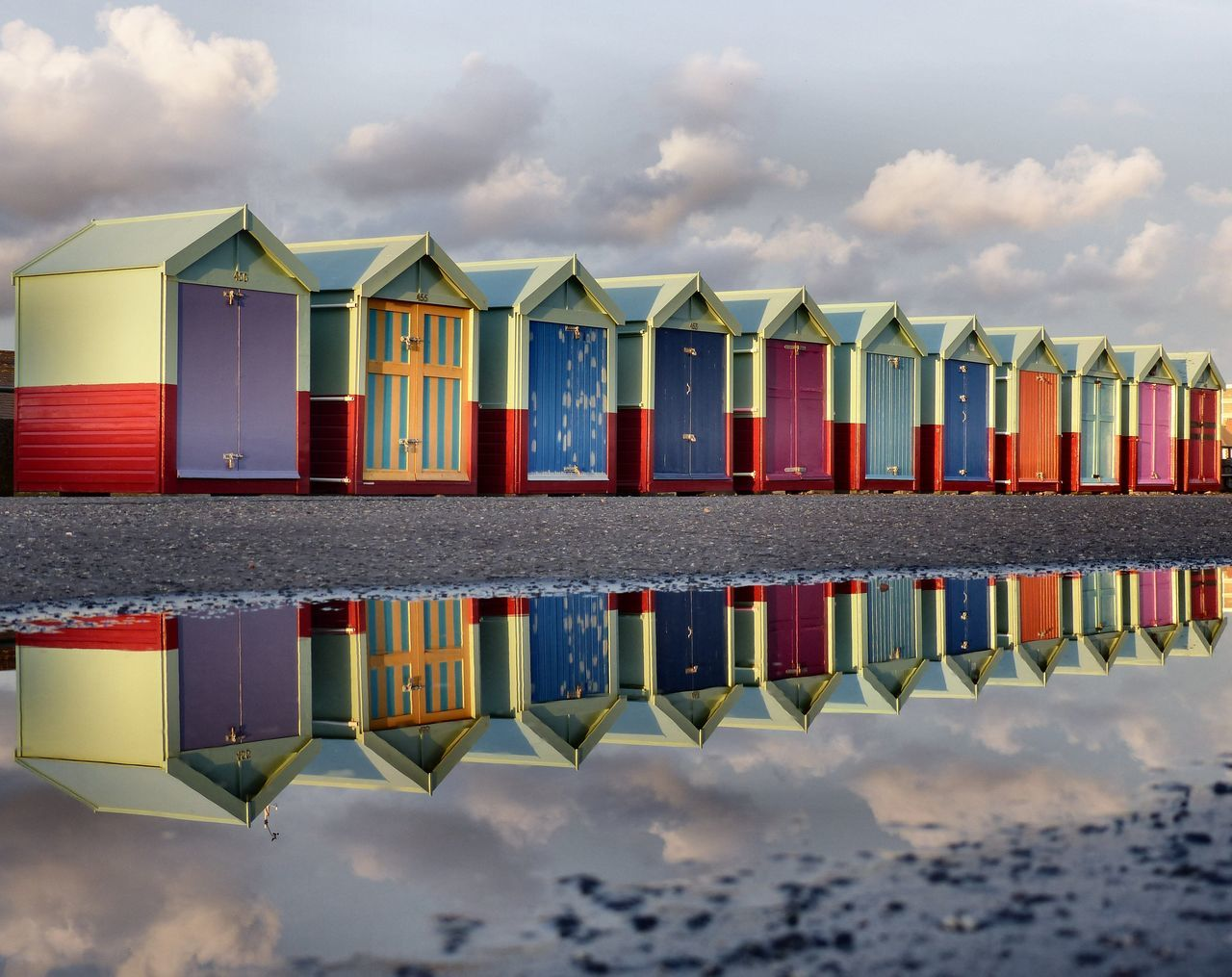 A view of Hove seafront - March 2017. Beach Huts Beachhuts Brighton Uk East Sussex England, UK Hove Promenade Reflections In The Water