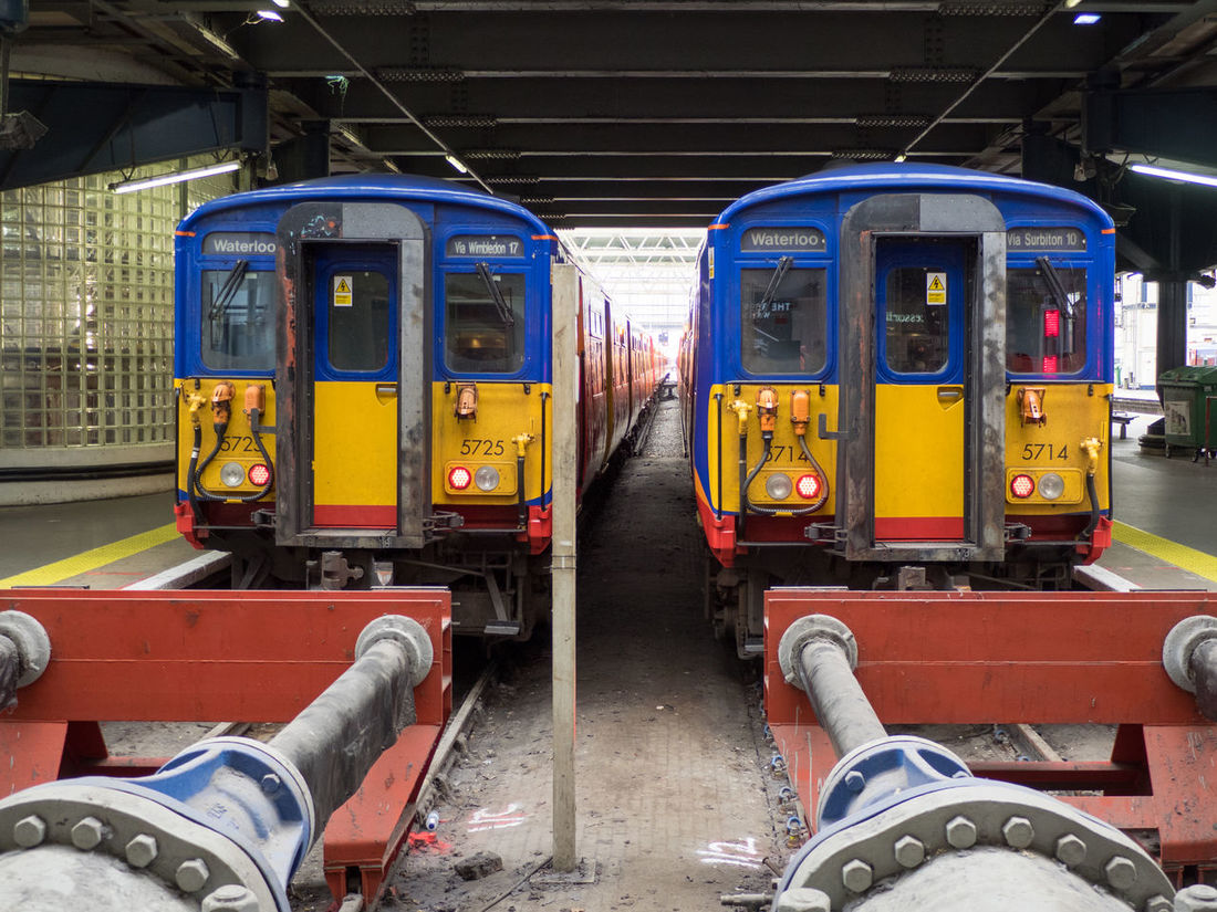 Waterloo via Wimbledon / Surbiton Decisions Decisions ... Paint The Town Yellow Red Blue Buffers Day End Of The Line Final Destination Land Vehicle Mode Of Transport No People Outdoors Public Transportation Rail Transportation Railroad Track Stationary Symmetry Train - Vehicle Transportation Yellow