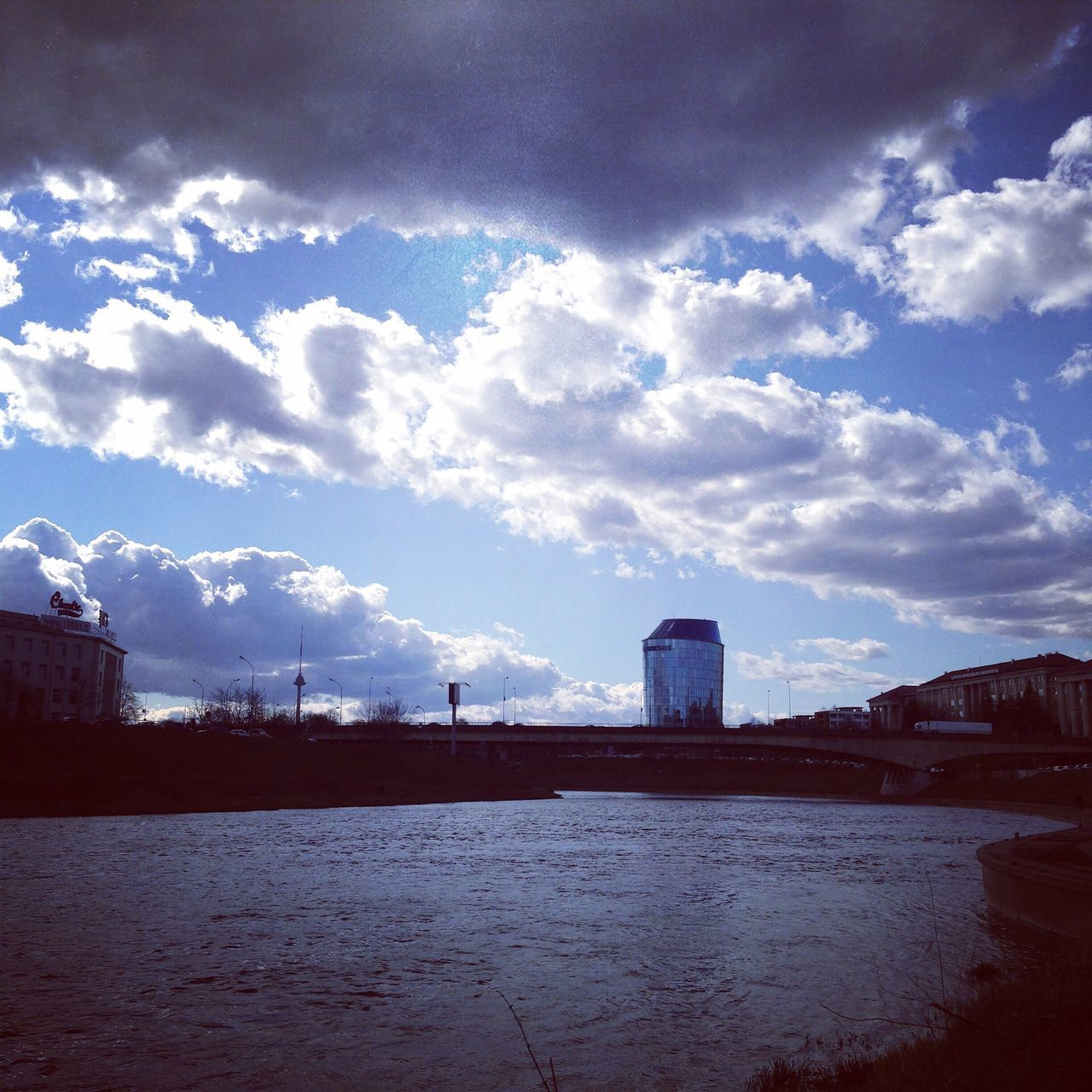 Architecture Sky Vilnius River Riverside River View Skyscraper Sky And Clouds Built Structure City Bridge Cloud - Sky Building Exterior Water No People Outdoors Day Nature City Industry Beauty In Nature TV Tower Reflection Water Reflections Clouds And Sky