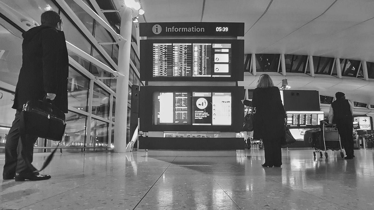Travel Indoors  Airport Railroad Station Arrival Departure Board Transportation Public Transportation Airport Departure Area Passenger Subway Train Text One Person People Airport Check-in Counter Adults Only Clock Only Men Day Airplane Ticket Adult