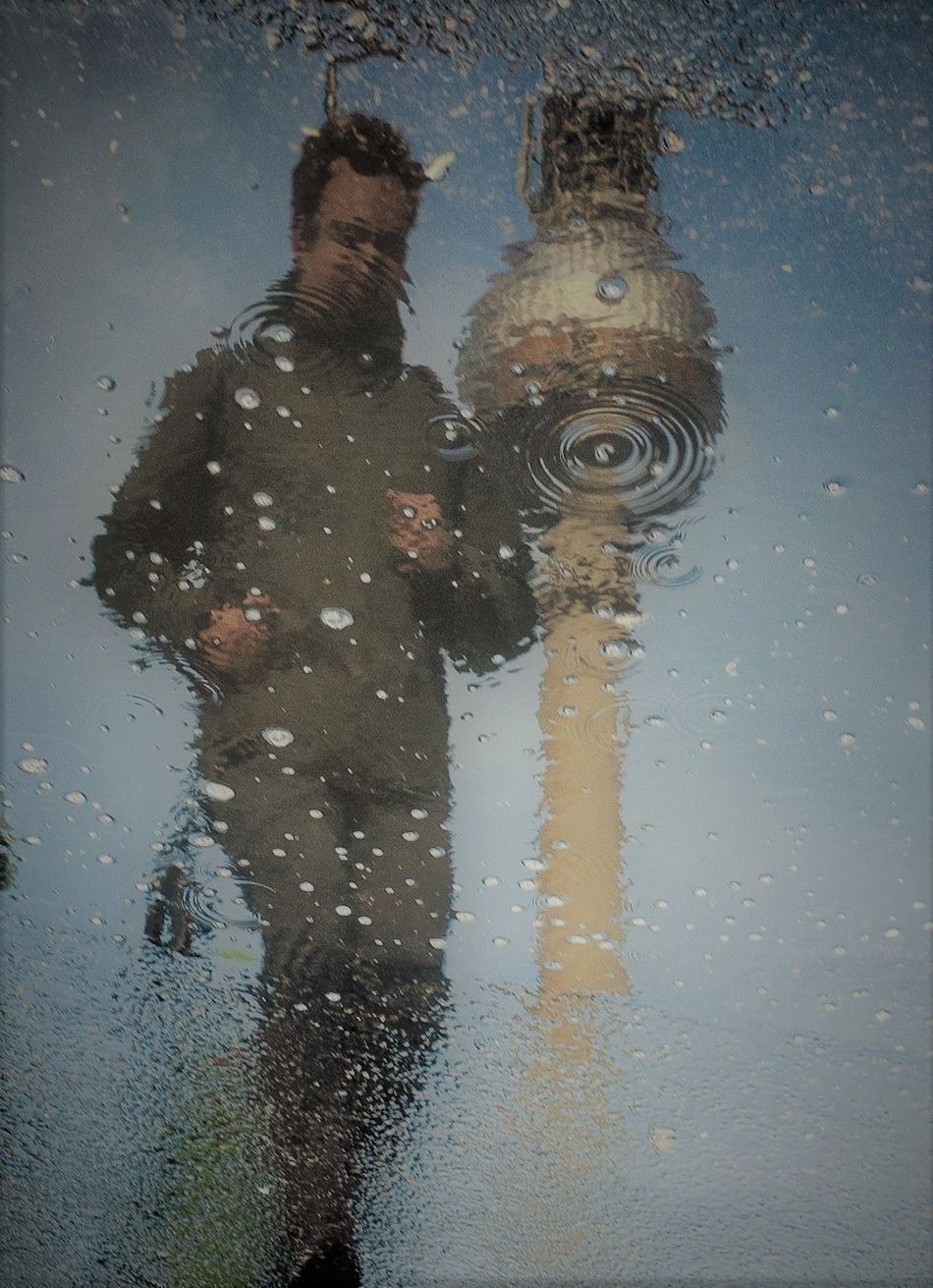Day Men One Man Only One Person Outdoors Puddle Rain Raindrops Real People Reflection Road Streetphotography Television Tower Water Wet