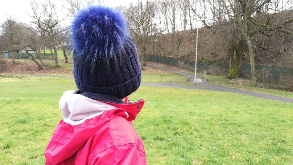 Tree One Person Rear View Real People Grass Leisure Activity Outdoors Lifestyles Day Green Color Warm Clothing Child Kid Boy Hat HEAD Jacket Park People Growing Up Scotland Children Outdoors Fresh Air Pom Pom