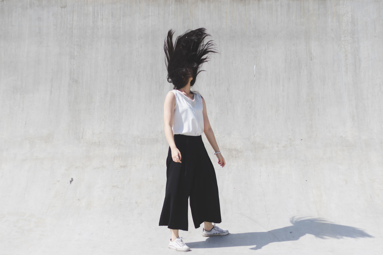 flick Hair Shakeoff Wall Abstract Adult Art Building Day Full Length Hipster Leisure Activity Lifestyles Motion One Person Outdoors People Real People Shadow Shadows Standing Strong Strongwoman Women Young Adult Young Women