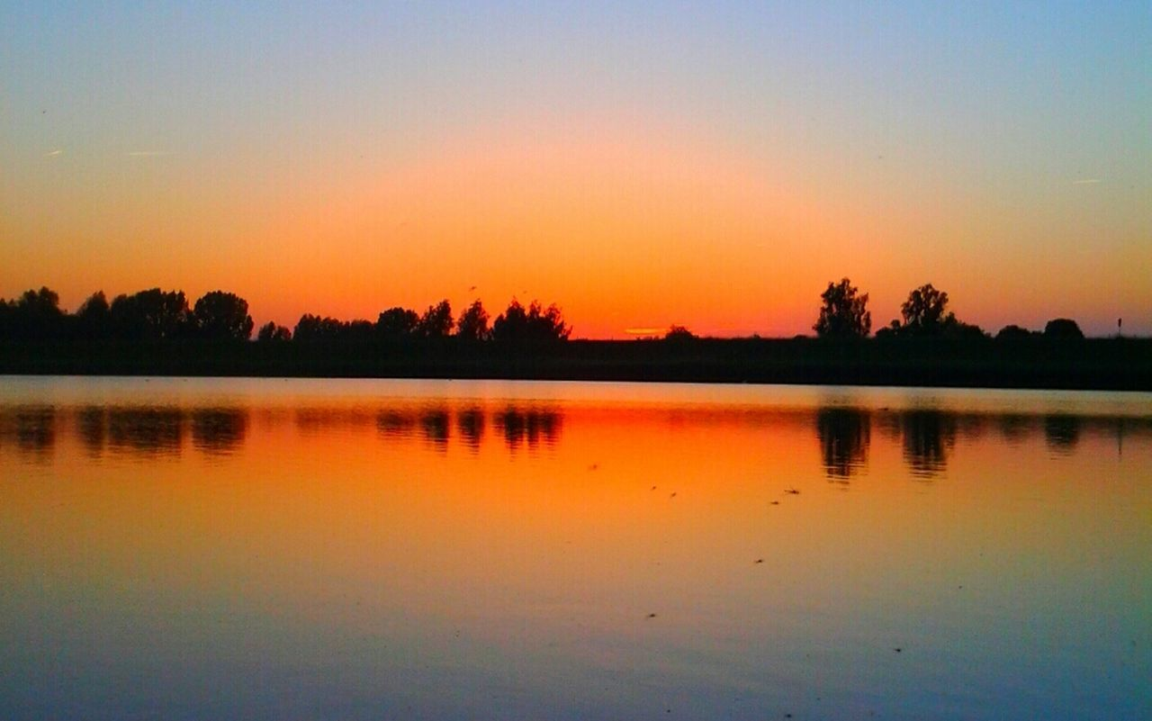 reflection, sunset, silhouette, nature, water, scenics, tranquil scene, beauty in nature, orange color, tranquility, lake, sky, tree, no people, outdoors, clear sky