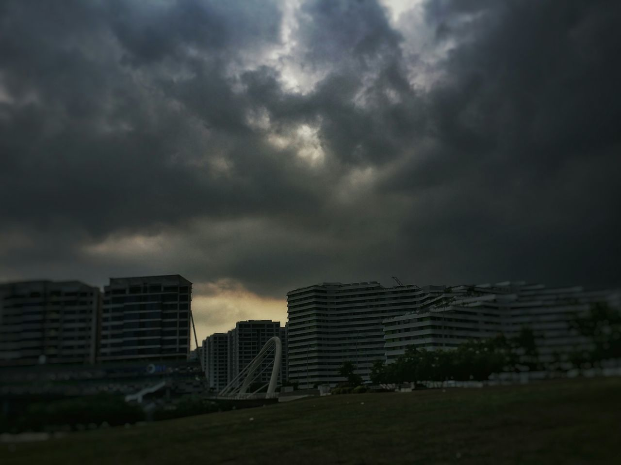 architecture, building exterior, cloud - sky, sky, built structure, skyscraper, city, outdoors, modern, storm cloud, no people, growth, day, cityscape, nature