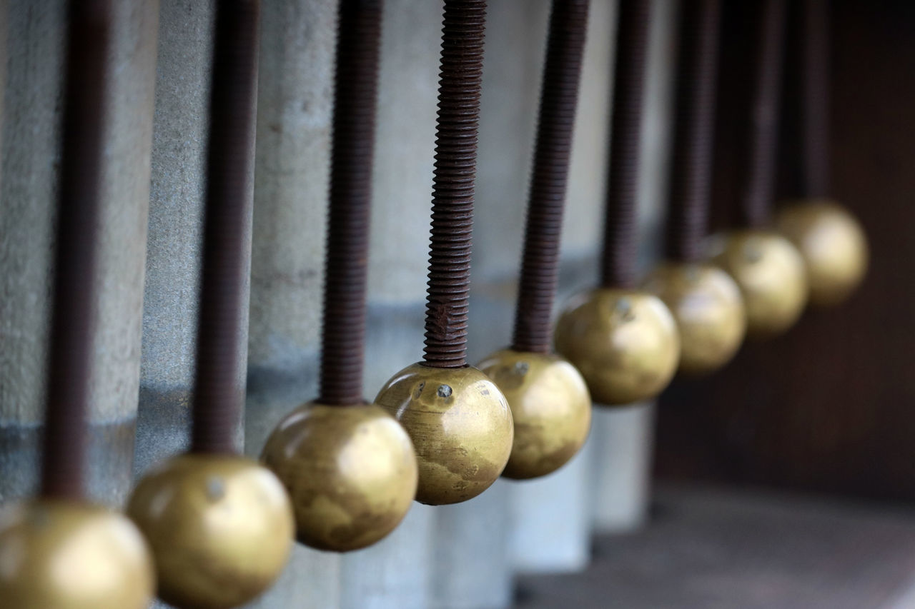 Balls Close-up Focus On Foreground Gold Golden Hanging Industrial Industrial Photography Making Music Metal Metallic Music Musical Instrument No People Rustic Screws Swinging Vintage