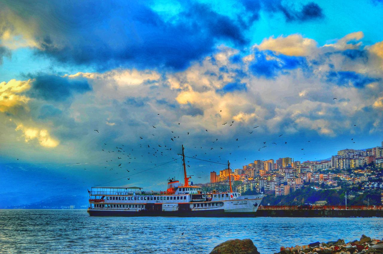 nautical vessel, water, cloud - sky, sky, sea, transportation, mode of transport, waterfront, nature, no people, outdoors, beauty in nature, scenics, built structure, day, building exterior, architecture