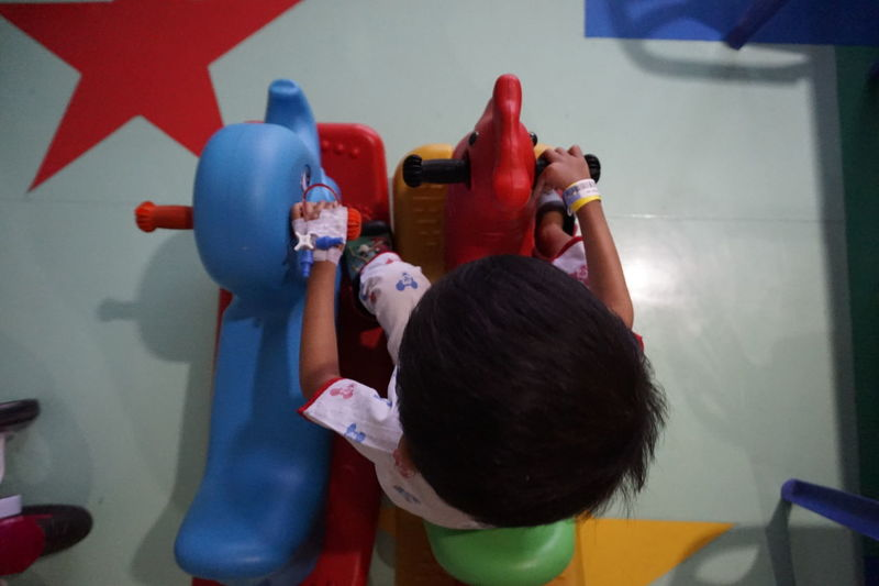 Boys Child Childhood Close-up Day Friendship Holding Indoors  Kids In Hospital Learning Leisure Activity Multi Colored People Playing Real People Standing Togetherness Toy Two People