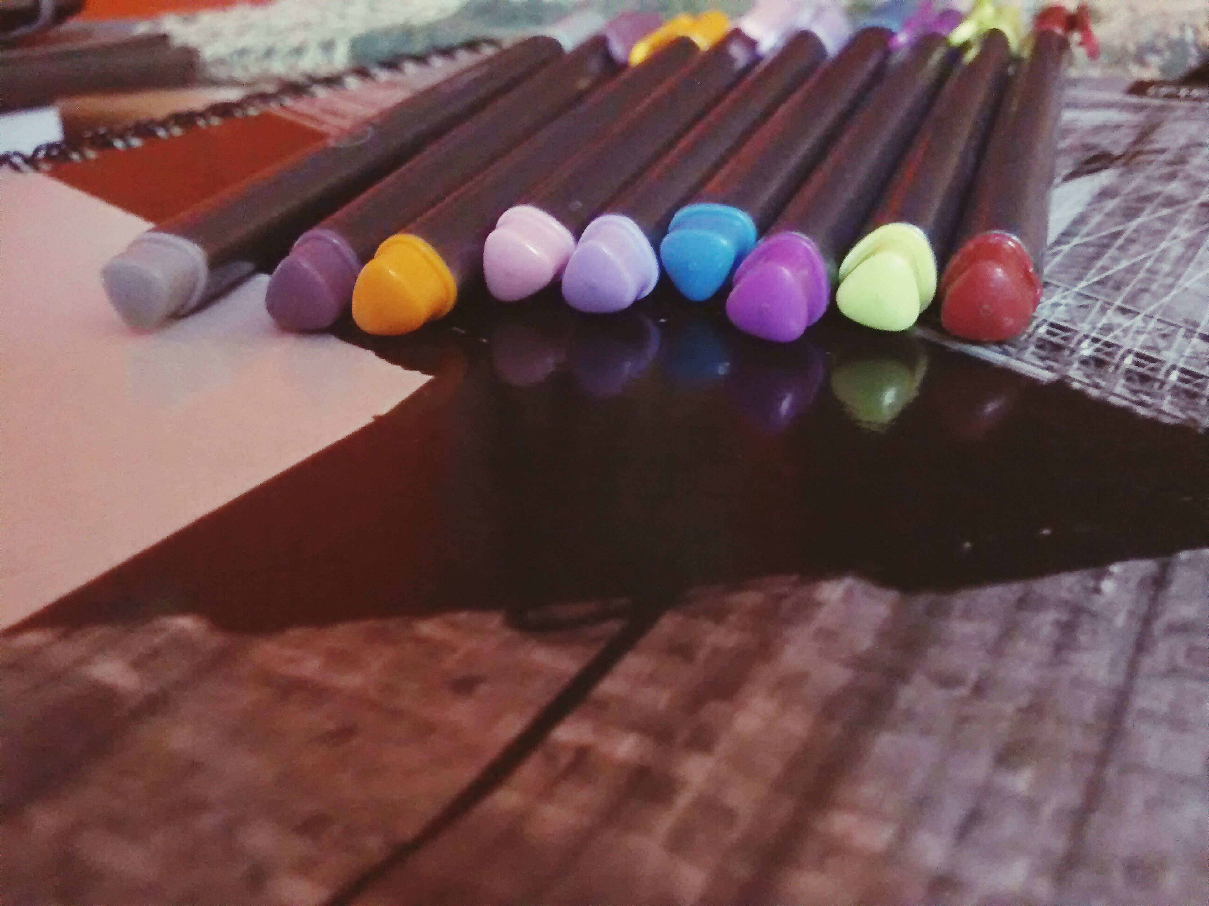 multi colored, table, wood - material, indoors, high angle view, still life, colorful, close-up, selective focus, variation, wooden, large group of objects, celebration, no people, focus on foreground, childhood, in a row, choice, decoration, arrangement
