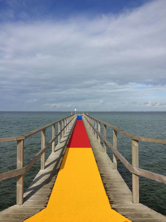 Blue Red Sea Water Railing The Way Forward Tranquil Scene Yellow Horizon Over Water Sky Long Tranquility Calm Cloud Jetty