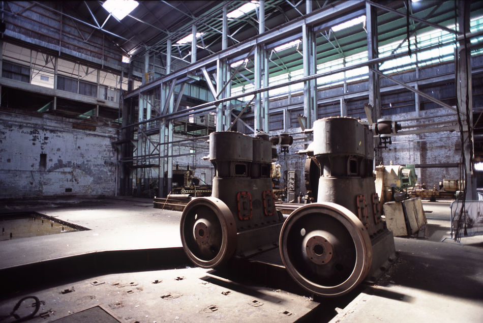abandoned heavy industrial workshop in a disused ship yard. Abandoned Boat Building Damaged Deterioration Factory Indoor Indoors  Industry Industy Lathe Light Metal Metal Works Obsolete Old Old-fashioned Power Press Router Ship Building Ship Yard Sun Workshop