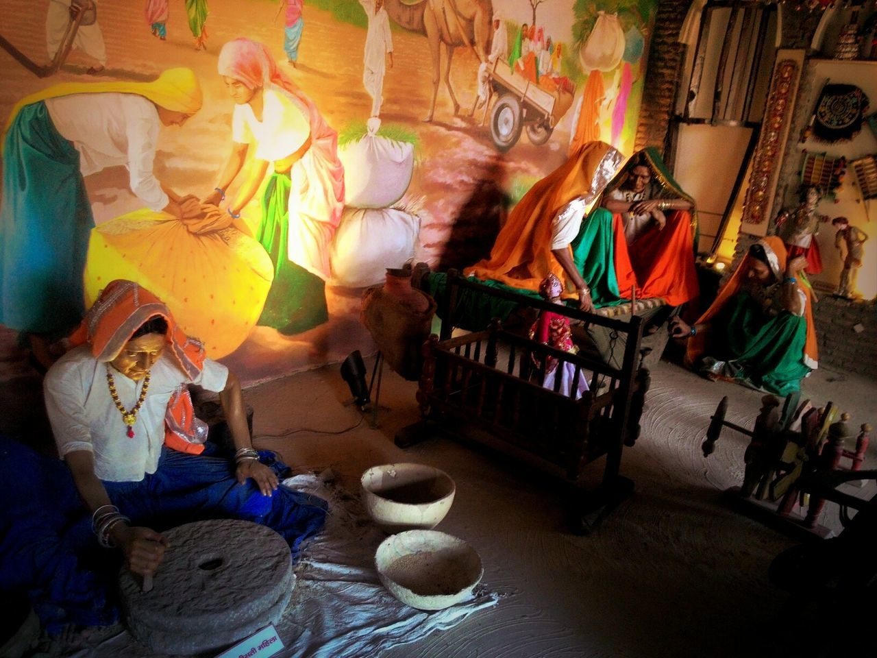 real people, indoors, sitting, traditional clothing, leisure activity, women, full length, men, lifestyles, togetherness, night, adult, young adult, people, adults only