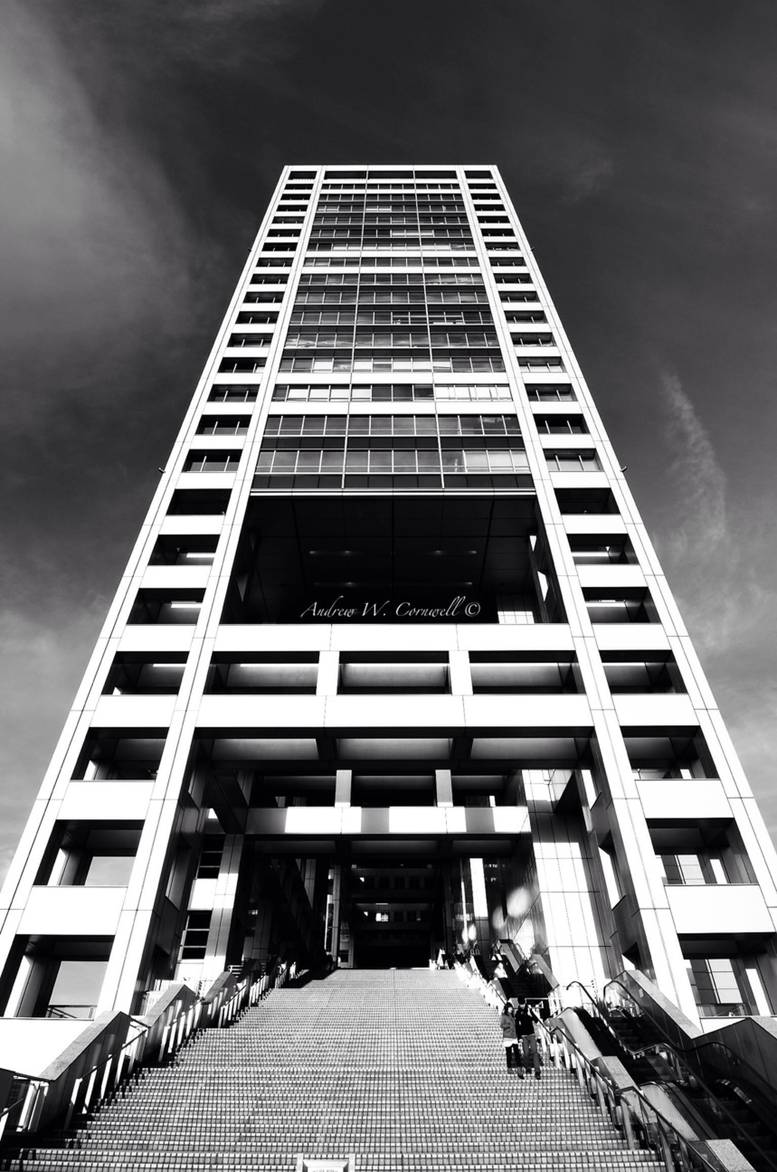 architecture, building exterior, built structure, low angle view, modern, office building, skyscraper, city, tall - high, sky, building, tower, tall, glass - material, diminishing perspective, day, reflection, outdoors, cloud - sky, window