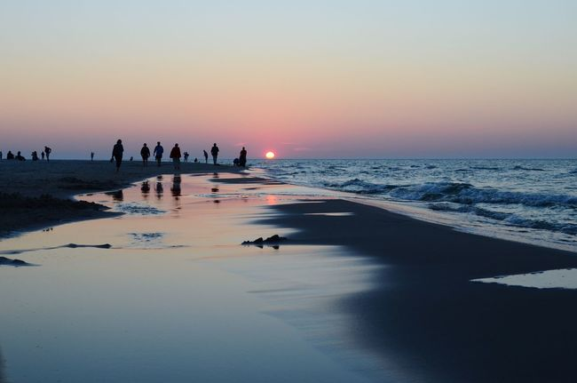 Sunset Baltic Sea Sea And Sky Beach Tranquil Scene Tranquility Water Sun Tourist Idyllic Pink Sky Mirroring In Water Reflection Water Reflections People Watching