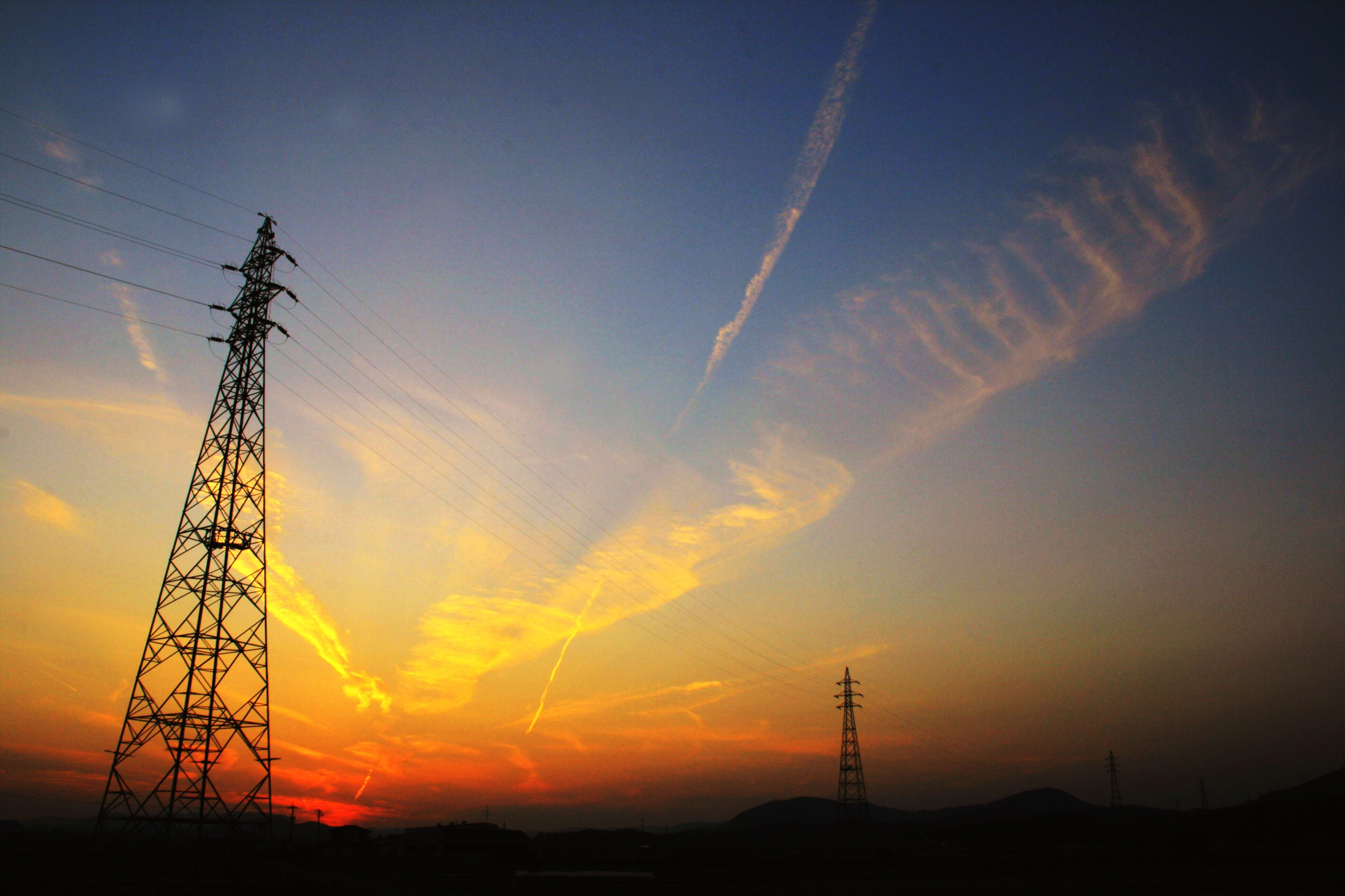 electricity pylon, sunset, power supply, fuel and power generation, power line, electricity, silhouette, technology, connection, low angle view, sky, orange color, cable, scenics, beauty in nature, tranquility, electricity tower, nature, tranquil scene, landscape