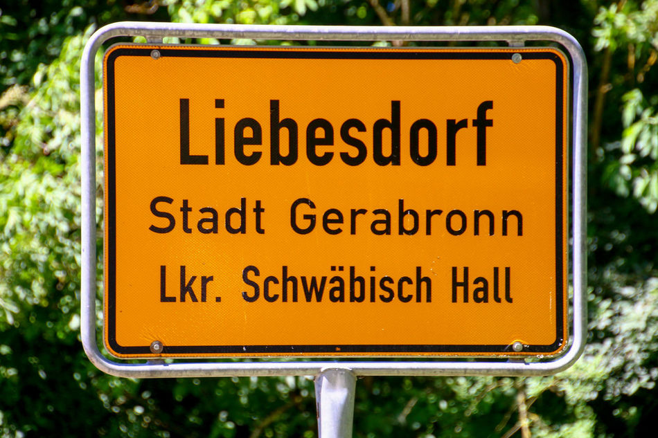 City Cityname Close-up Dorf Entrance Liebe Liebesdorf Love No People Ort Ortseingangschild Outdoors Road Sign Stadtname Straßenschild Streetphotography Text Travel Travellover Yellow