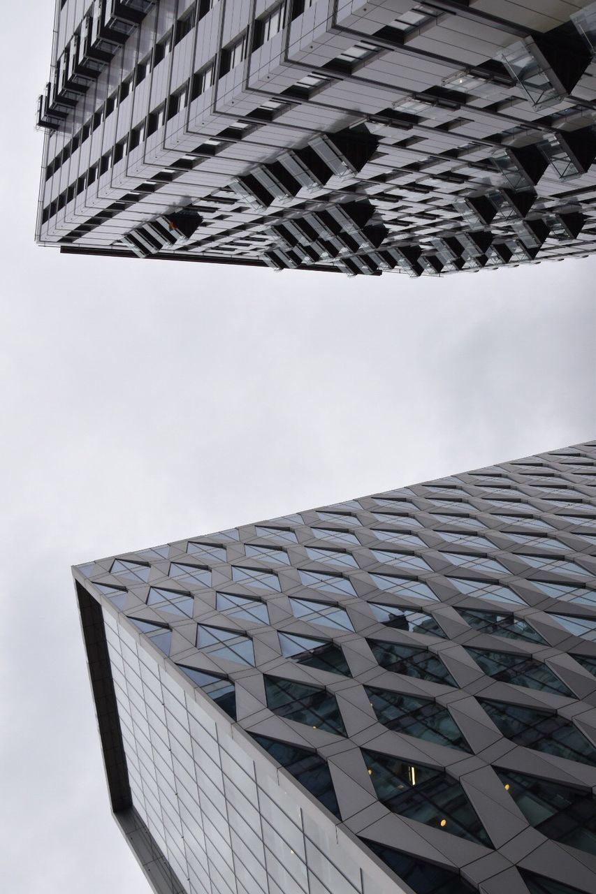 architecture, building exterior, built structure, modern, city, low angle view, skyscraper, outdoors, day, no people, tall, sky