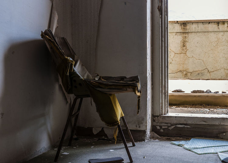 Vandalized Building Built Structure Chair Close-up Day Destroyed Chair Deterioration Dirty Empty Lost Place No People Ruined Seat Vandalized Zerstört