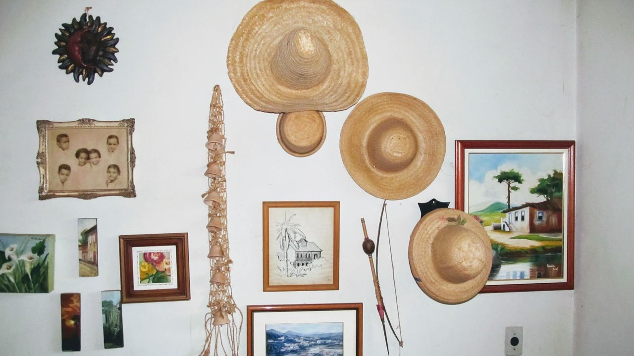 indoors, hat, hanging, picture frame, no people, day, close-up