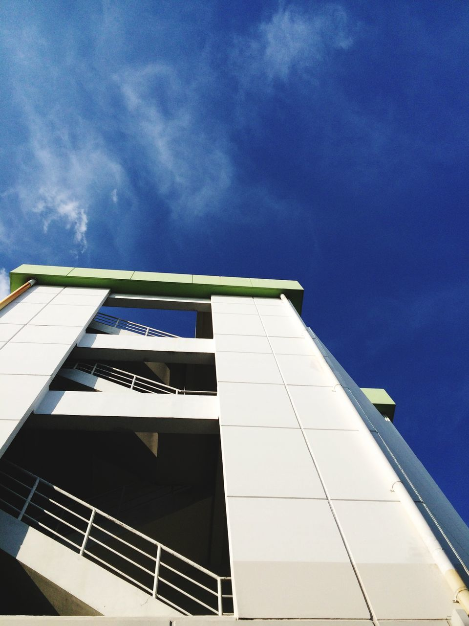 architecture, low angle view, sky, built structure, blue, building exterior, no people, day, outdoors