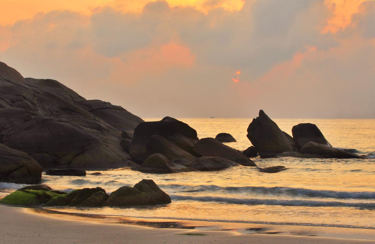 sea, sunset, nature, beauty in nature, sky, horizon over water, no people, outdoors, water, scenics, day, iceberg, mammal