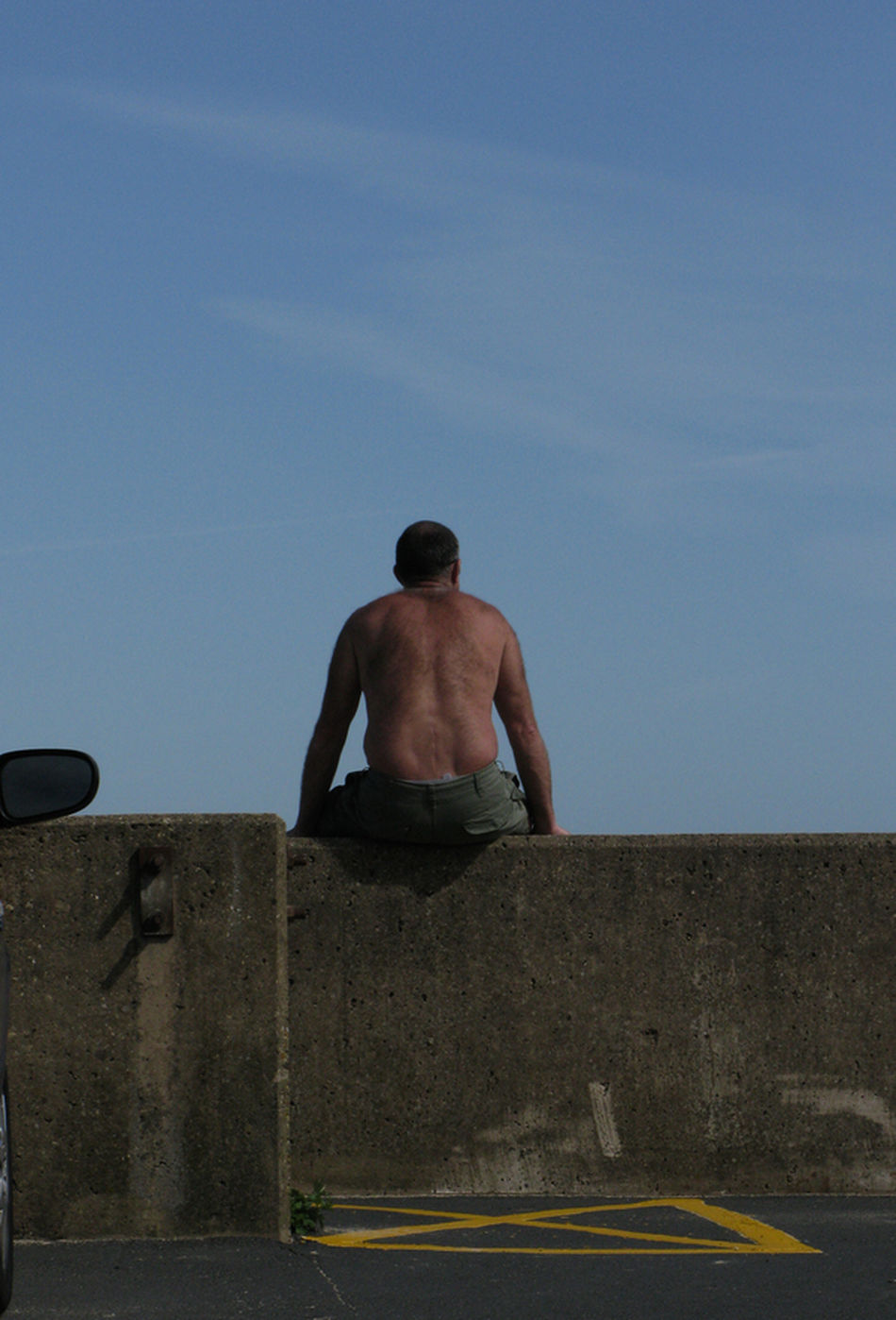 The British on Holiday, just sat on the wall Balance Carefree Day Escapism Front View Full Length Getting Away From It All Leisure Activity Lifestyles Man Sat On Wall Against Blue Sky Men Person Real People Shirtless Standing Summer The British At The Seaside On Holiday Kids Children Two 2 Girls On Jetty Watch Dingy Deep In Thought Seaside Jetty Water Wake Dingy Orange Sand Coastline Suffolk Horizon Documentary Reportage Photography Taking Shots Colour Color Dresses From My Point Of  The British On Holiday By The Seaside Waves White Crest Foam Sea Ocean Beach Sand Bathing Trunks Crocks Thinking Deep Thoughts Contemplation Man Male White Pale Lonly Looking Figure Sad Sadness Documentary Reportage Photography Photograph Photographer Col Three Quarter Length Young Adult Young Men