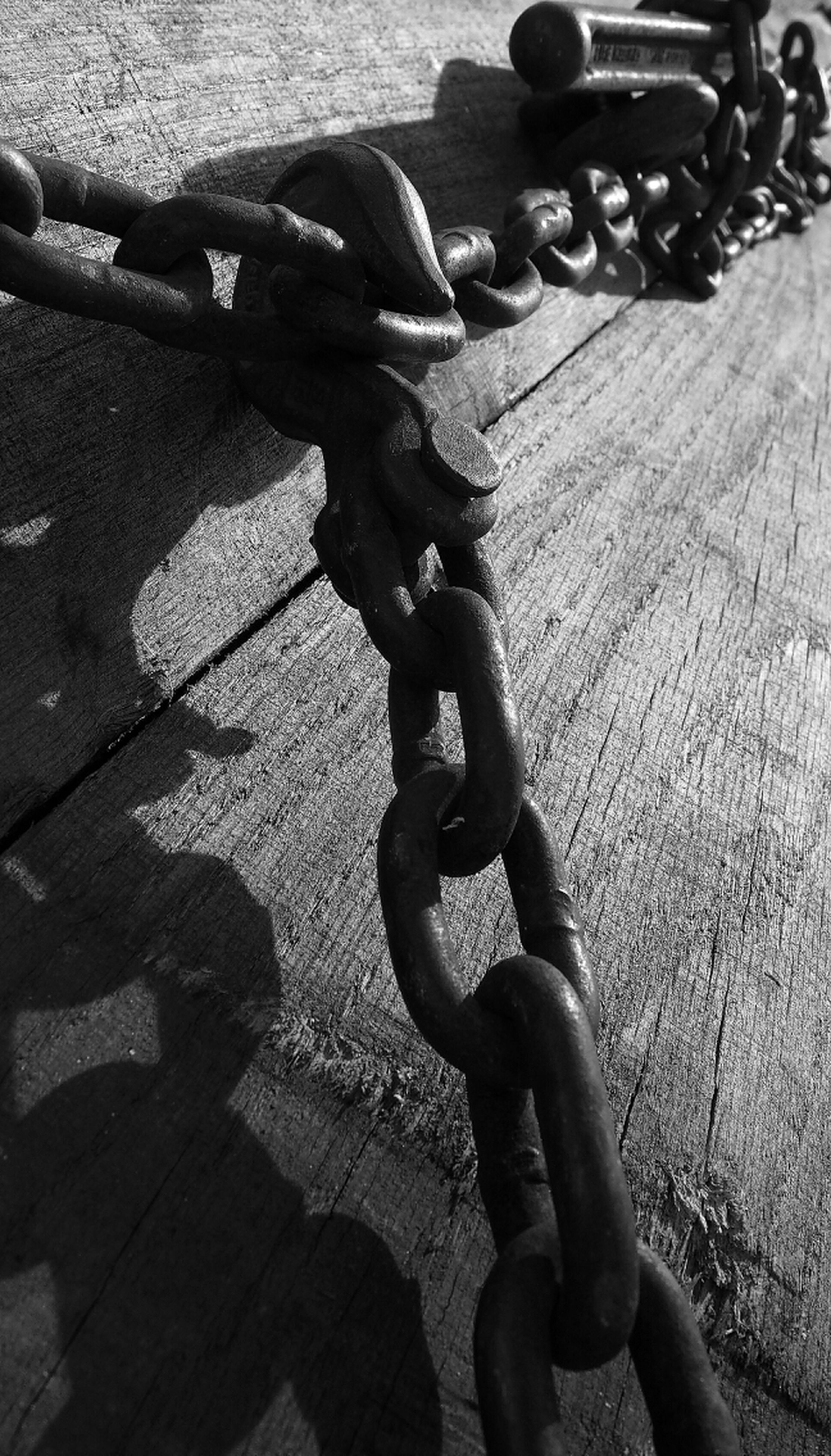 chain, metal, high angle view, security, safety, bicycle, protection, love, childhood, shadow, metallic, close-up, outdoors, day, connection, sunlight, street, rope, strength