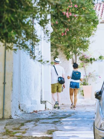 Walking Two People Rear View Full Length Day Men Tree Lifestyles Real People People Standing Outdoors Adult Women Water Nature Leisure Activity Togetherness Adults Only Young Adult