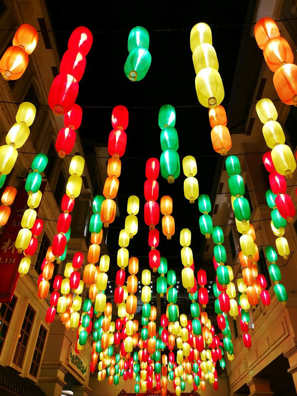 multi colored, lighting equipment, low angle view, illuminated, hanging, no people, night, celebration, large group of objects, lantern, outdoors, close-up