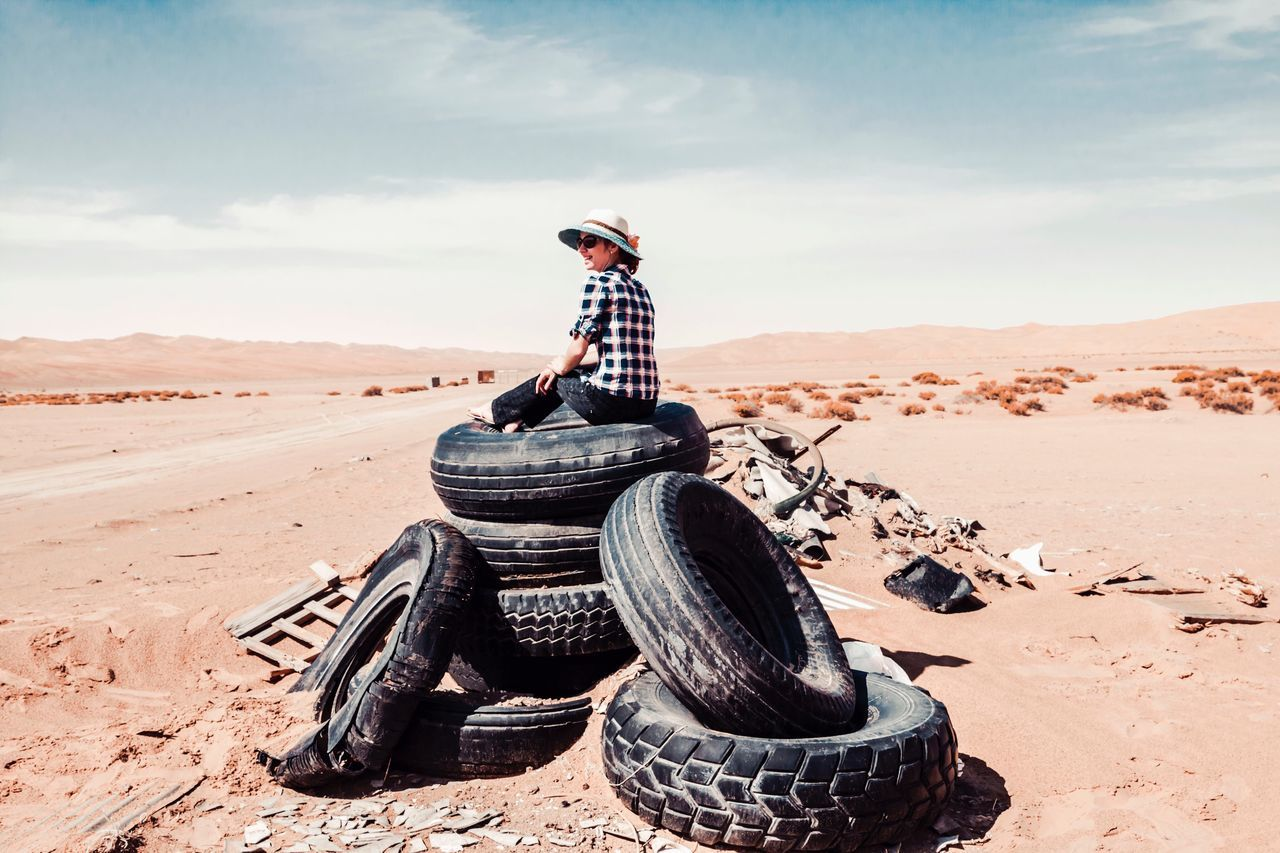 Sand Day Desert Outdoors One Person Real People Standing Sitting Sky Full Length Arid Climate Boys Childhood Nature Young Adult People The Great Outdoors - 2017 EyeEm Awards Liwa