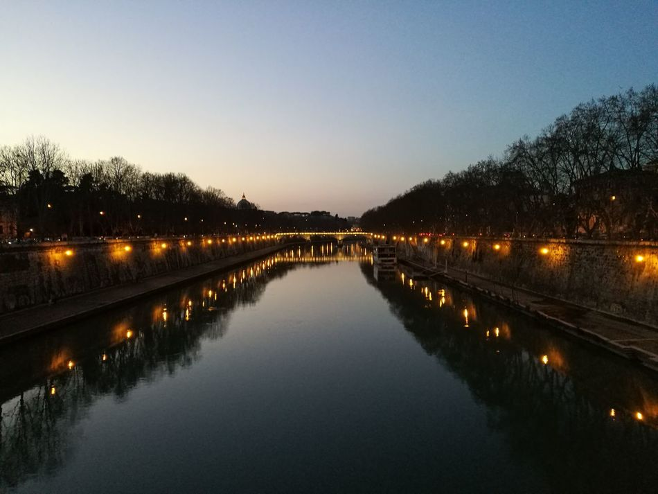 You can just make out the dome of St Peters in the background Reflection Sunset Water Illuminated Bridge - Man Made Structure Bridge Bridge Over Water River River Tiber Tiber River Tiber View Travel Travel Destinations Rome Italy🇮🇹 Rome Roma Travel Photography No Filter, No Edit, Just Photography No Filter Ponte Sisto Outdoors Night Nature Beauty In Nature