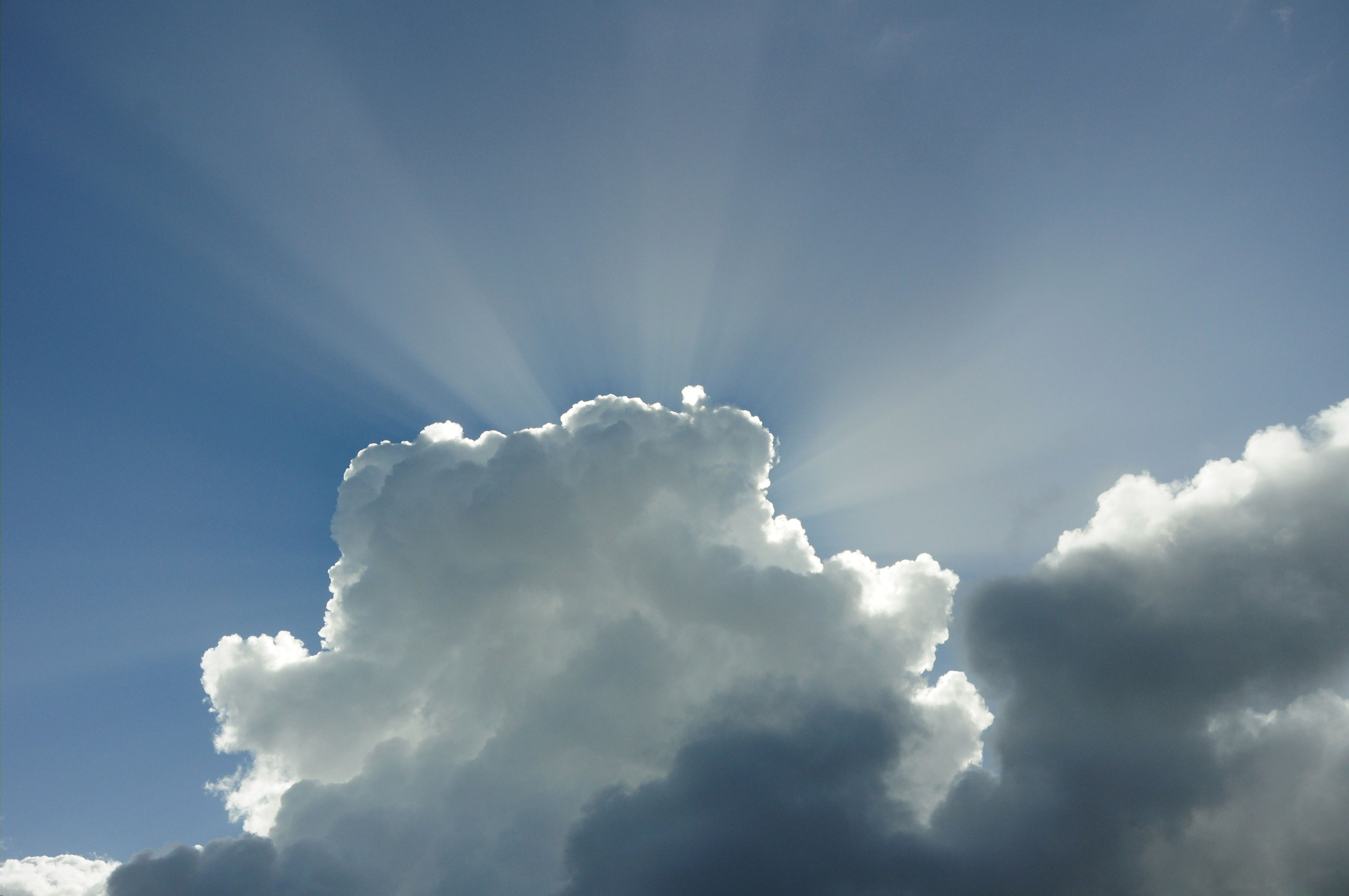 low angle view, sky, blue, cloud - sky, sky only, beauty in nature, scenics, nature, tranquility, sunbeam, tranquil scene, cloudscape, cloud, cloudy, sunlight, white color, day, sun, idyllic, outdoors
