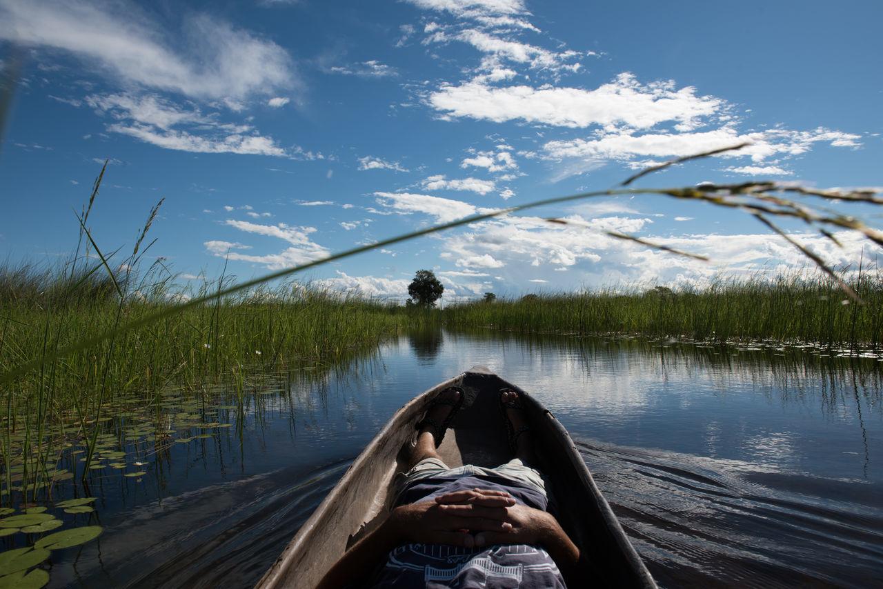 Man in Canoe Africa Boat Botswana Canoe Light Man Okavango Delta Outdoor Outdoors Sky Sunrise Swamp Travel Water Wilderness The Great Outdoors - 2016 EyeEm Awards