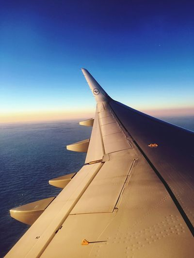 Airplane Part Of Flying Aircraft Wing Transportation Cropped Air Vehicle Mode Of Transport Clear Sky Blue Cloud Sky Journey Aerial View Mid-air Airplane Wing Outdoors Day Scenics No People