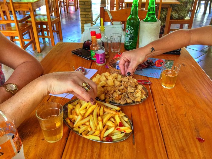 Torresmo Beer - Alcohol Food And Drink French Fries Prepared Potato Drink Table Human Hand Drinking Glass Human Body Part Alcohol Food Beer Glass Drinking Unhealthy Eating Refreshment Friendship Indoors  Beer Happy Hour Plate