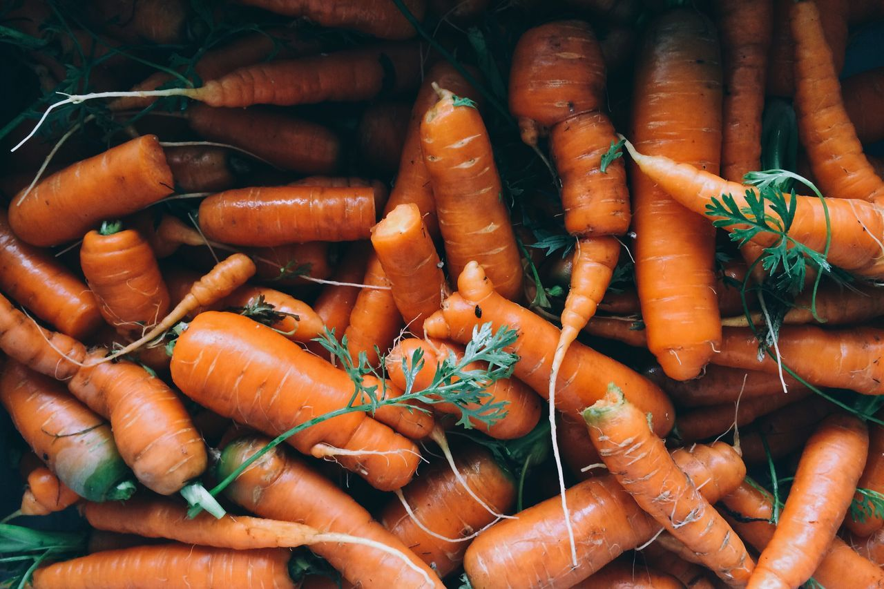 High Angle View Of Fresh Carrots For Sale On Market Stall