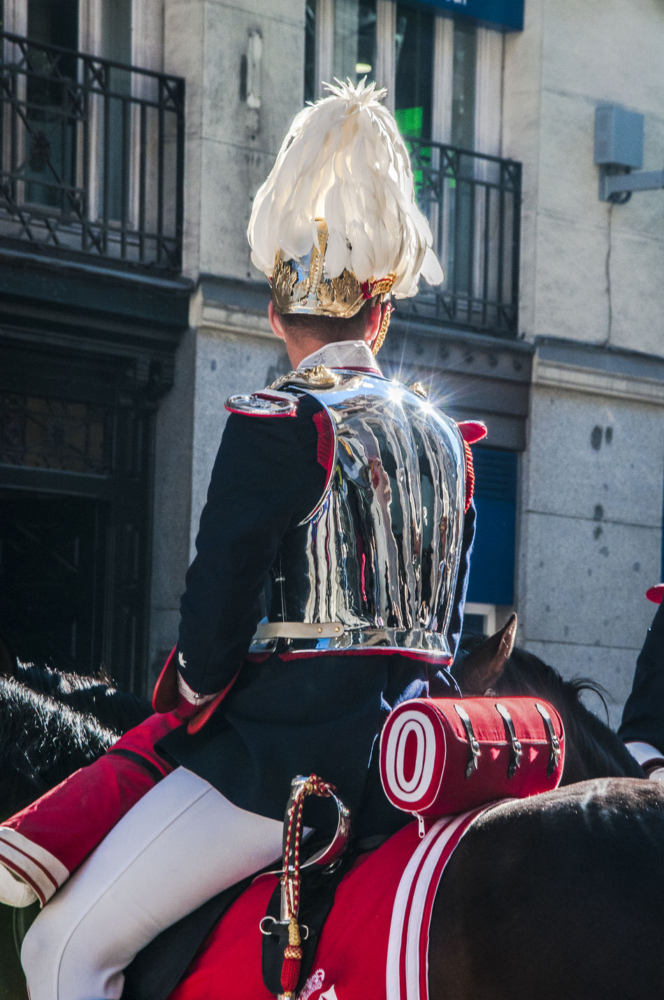 Back view view of a mounted cavalery soldier in full ceremonial uniform. Adult Back Cavalry City Close-up Editorial  Guard Horse Horses Military Mounted News One Person Only Men People Sitting Street Travel Uniform Uniforme Uniforms