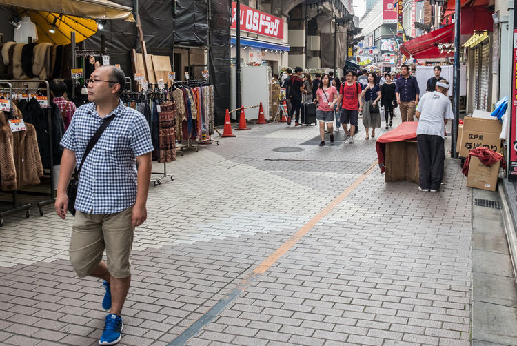 Street scene at Ameya Yokocho market in Tokyo. The street is popular among tourists and locals for who are searching for bargains and low price items. Ameyayokocho Japan People Scene Shop Small Shop Stall Street Street Photography Tokyo Tourism Tourist Tourist Attractions Ueno Vendor View Water