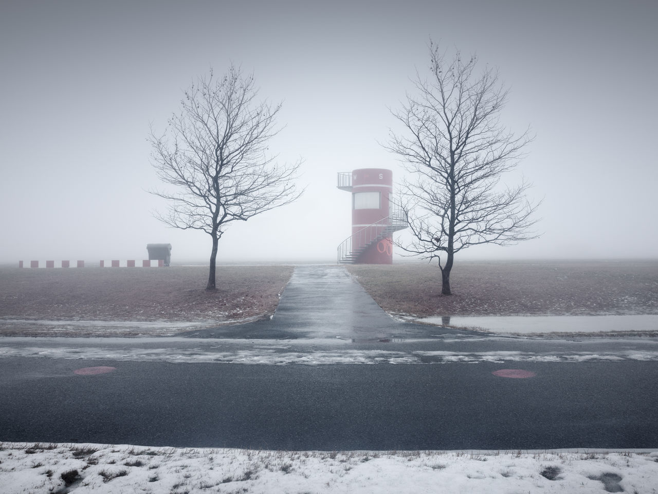 winter scene at tempelhofer field berlin Bare Tree Beauty In Nature Berlin Clear Sky Cold Temperature Day Fine Art Long Exposure Muted Colors Nature No People Outdoors Philipp Dase Road Sky Snow Tempelhofer Feld Tree Weather Winter