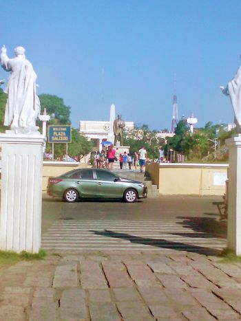 Statue Car Human Representation Sculpture Transportation Day Outdoors Sky Clear Sky No People City Vigan Philippines Building Exterior City Church Eyemphilippines Religion Built Structure Architectural Column Outdoor Photography History Architecture