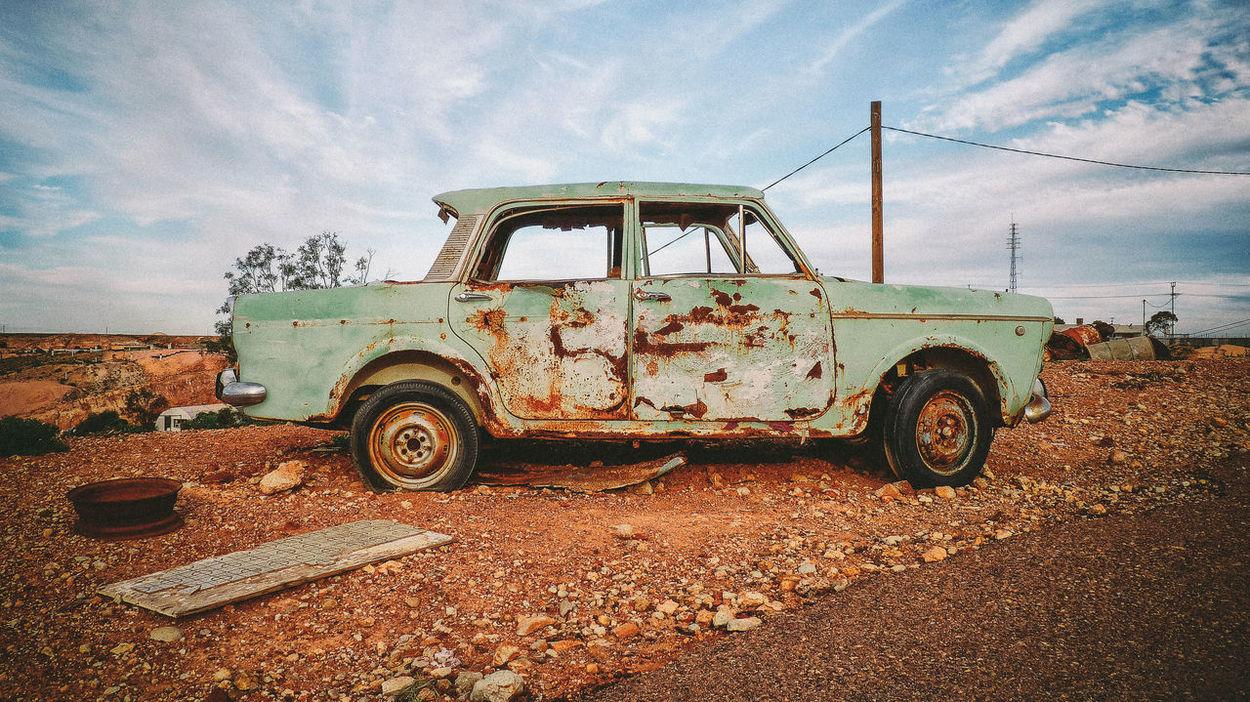 An old car wreck in the Australian opal mining town Coober Pedy. Australia Australian Outback Car Car Wreck Coober Pedy Desert Dust Green Mining Town Old Old Car Opal Opal Mining Outback Red Savage Travel Wreck