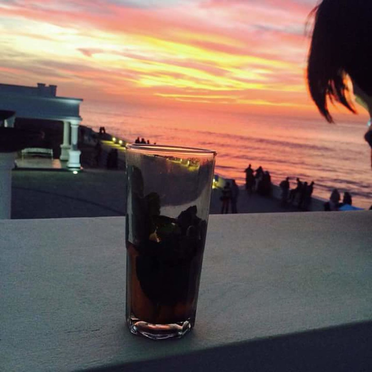 drink, sunset, refreshment, drinking glass, sky, food and drink, cocktail, alcohol, outdoors, table, cloud - sky, drinking straw, close-up, mojito, freshness, sea, no people, nature, day