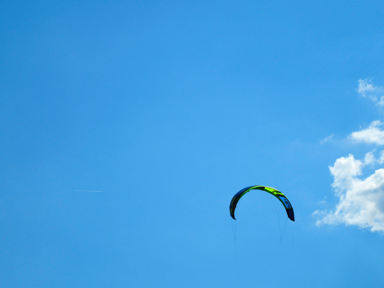 Kite surf over clear blue sky Adventure Beauty In Nature Blue Clear Sky Copy Space Copy Space Day Extreme Sports Flying Kitesurfing Leisure Activity Lifestyles Low Angle View Mid-air Nature One Person Outdoors Parachute Paragliding People Real People Sky Sport
