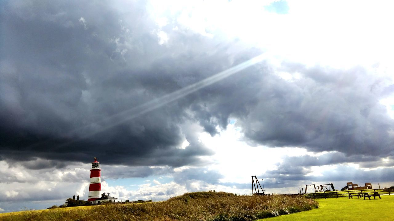 cloud - sky, sky, day, lighthouse, built structure, nature, no people, outdoors, field, building exterior, architecture, grass, beauty in nature, landscape, scenics
