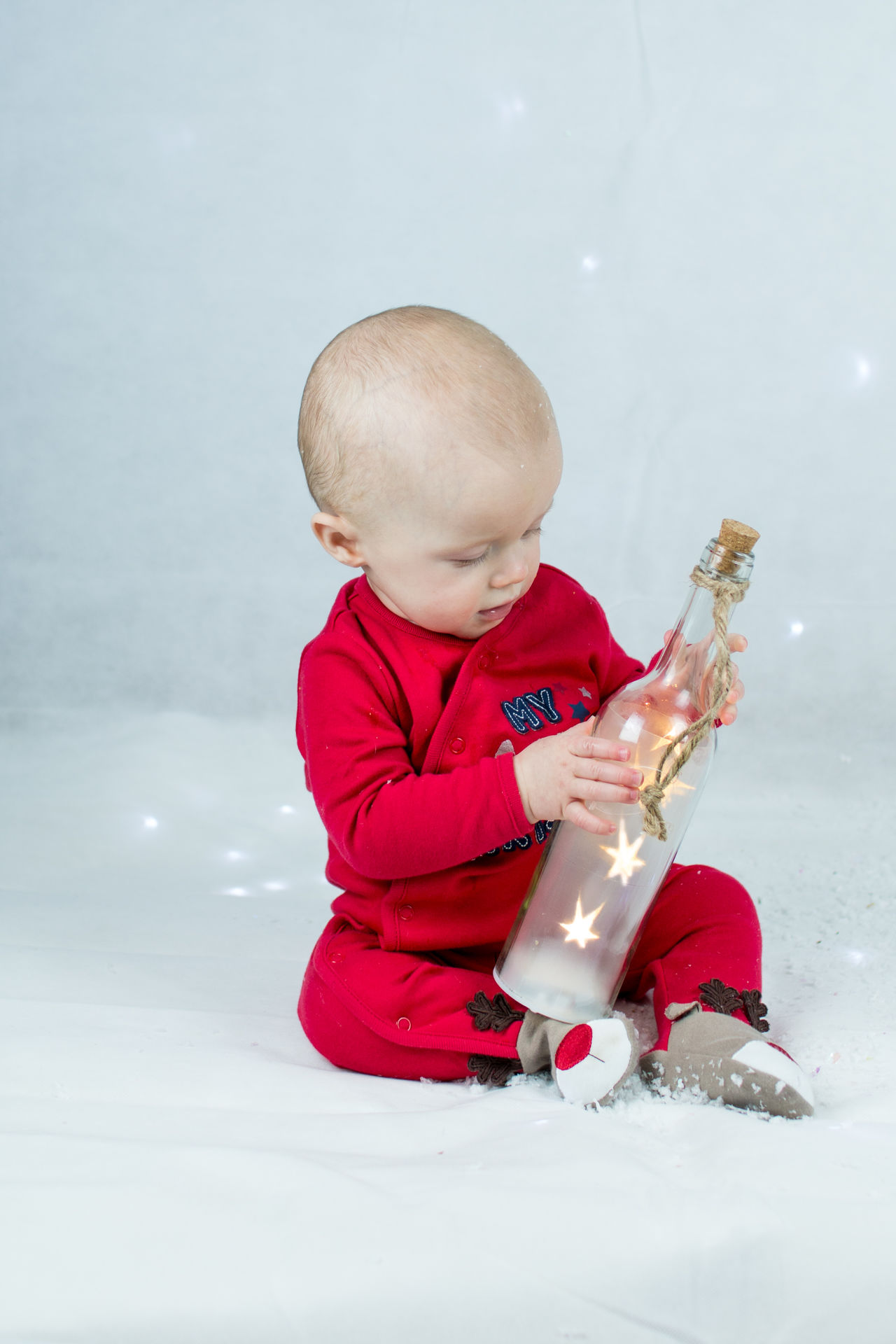 The curious baby Baby Baby Learning Baby Playing Child Childhood Children Only Christmas Fun Curious Baby Cute Baby Day Festive Fun Festive Fun Full Length Fun One Person People Playing Red Snow Snow Scene  Stars In Bottle Streamzoofamily Winter