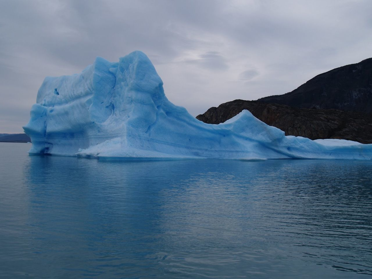 waterfront, glacier, beauty in nature, nature, iceberg, ice, cold temperature, water, tranquility, scenics, lake, no people, mountain, sky, outdoors, day, glacial