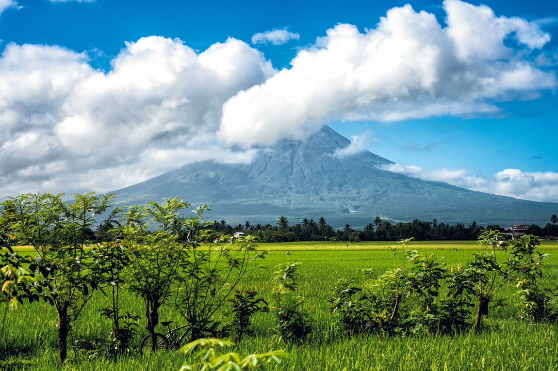 The awesome Mayon Volcano Philippines Agriculture Airplane View Beauty In Nature Clouds Clouds And Sky Clouds Formation Day Field Green Color Landscape Mayon Mayon Volcano Mountain Mt Mayon Nature No People Outdoors Perfect Cone Volcano Rice Field Rural Scene Scenics Sky Tranquil Scene Tranquility